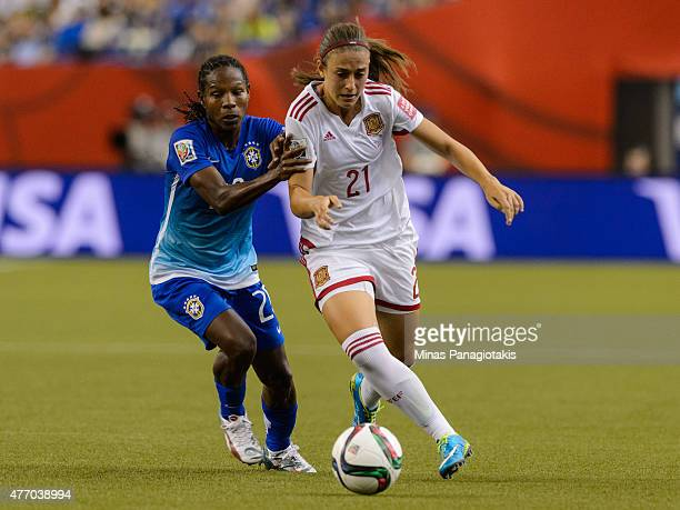 Formiga of Brazil challenges Alexia Putellas of Spain during the 2015 FIFA Women's World Cup Group E match at Olympic Stadium on June 13 2015 in...