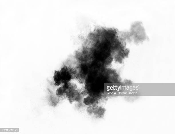 Forms and textures of an explosion of a powder of color gray on a  white background