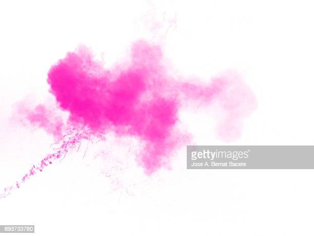 Forms and textures of an explosion of a powder of color pink on a  white bottom