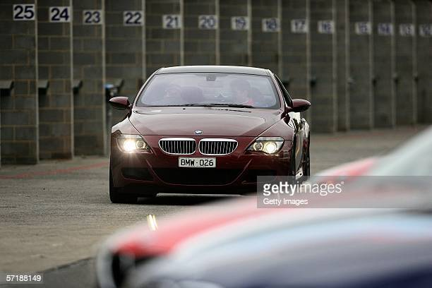 Formula 1 Driver Jacques Villeneuve test drives the new BMW M6 during a training session in preparation for the upcoming BMW Celebrity Challenge at...