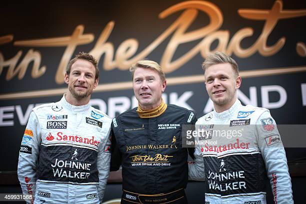 Formula 1 driver Jenson Button of McLaren former Formula 1 driver and Johnnie Walker Global Responsible Drinking Ambassador Mika Hakkinen and Formula...