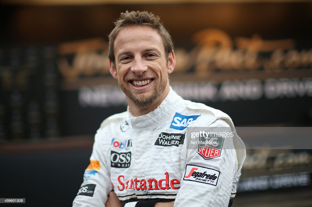 Formula 1 driver <a gi-track='captionPersonalityLinkClicked' href=/galleries/search?phrase=Jenson+Button&family=editorial&specificpeople=171505 ng-click='$event.stopPropagation()'>Jenson Button</a> of McLaren helps launch Johnnie Walker responsible drinking initiative 'Join the Pact ' for the festive season, in which 250,000 kilometres of safe rides home will be given, in Princess Street Gardens on December 04, 2014 Edinburgh, Scotland.