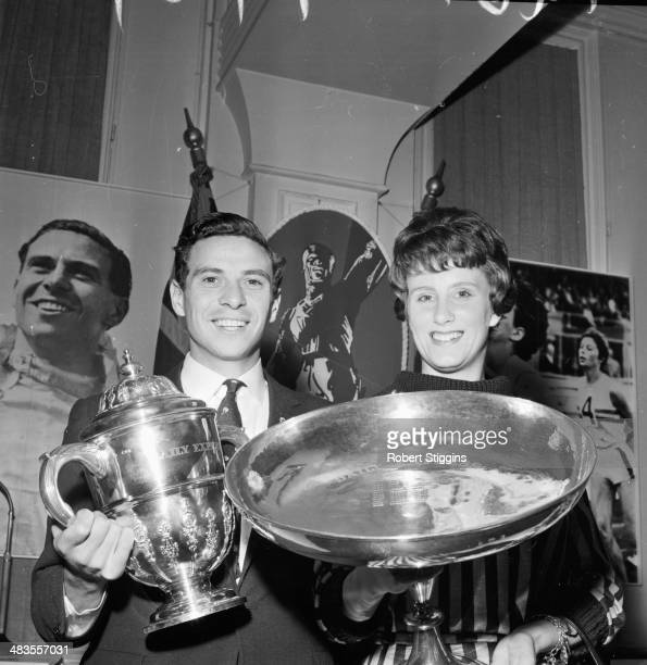 Formula 1 driver Jim Clark and athlete Dorothy Hyman holding their trophies after winning Sportsman and Sports woman of the Year London November 15th...