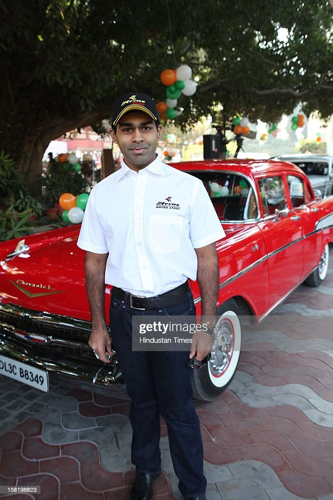 Formula 1 Driver Karun Chandhok poses during Vinatage car rally organised by the JK Tyre and Constitution Club of India on December 8, 2012 in New Delhi, India.