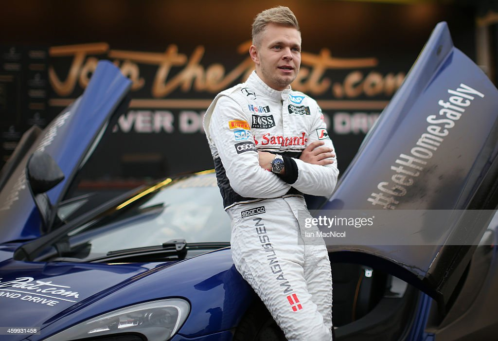 Formula 1 driver <a gi-track='captionPersonalityLinkClicked' href=/galleries/search?phrase=Kevin+Magnussen&family=editorial&specificpeople=7882003 ng-click='$event.stopPropagation()'>Kevin Magnussen</a> of McLaren helps launch Johnnie Walker responsible drinking initiative 'Join the Pact ' for the festive season, in which 250,000 kilometres of safe rides home will be given, in Princess Street Gardens on December 04, 2014 Edinburgh, Scotland.