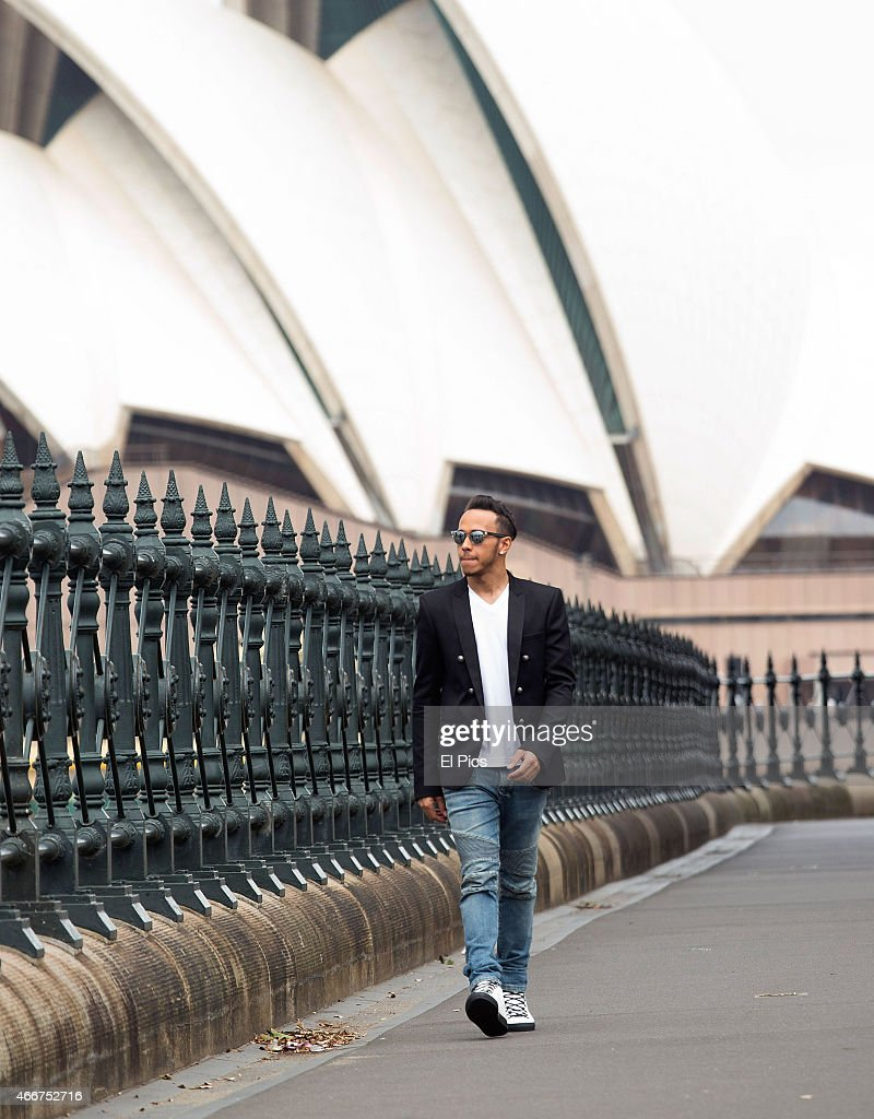 Formula 1 driver Lewis Hamilton of Great Britain and Mercedes GP is seen walking under the Sydney Harbour Bridge with the Sydney Opera House in the...