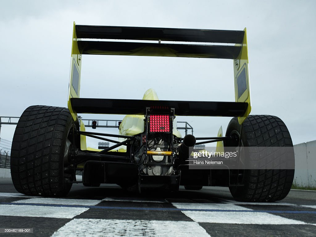 Formula 1 race car on track, rear view : Stock Photo