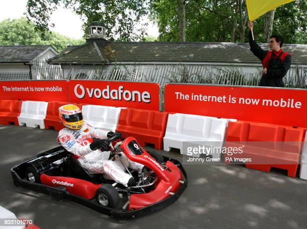 Formula 1 racing driver Lewis Hamilton drives a kart at the launch of the Vodaphone mobile internet in central London