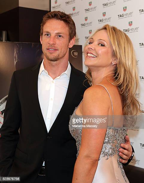 Formula 1 World Champion Jenson Button poses with actress Carla Bonner at the Tag Heuer boutique in Melbourne where he was the honoree for the night...