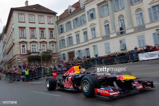 Formula 1 World Champion Sebastian Vettel performs during a showrun in his Red Bull Racing RB82012 car on December 1 2012 in Graz Austria