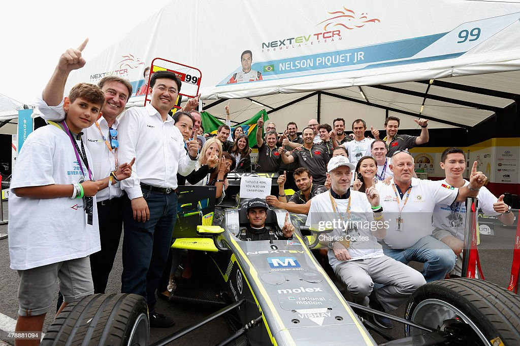 Formula E champion Nelson Piquet Jnr of Brazil celebrates his victory with his NEXTEV TCR team at Battersea Park Track on June 28 2015 in London...