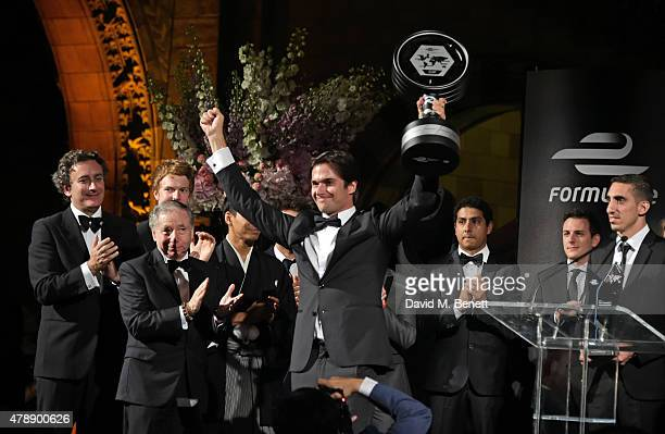 Formula E Championships winner Nelson Piquet Jr celebrates his win on stage at the 2015 FIA Formula E Visa London ePrix Gala Dinner at the Natural...