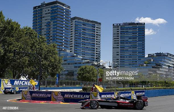 Formula E Mahindra Racing's Indian driver Karun Chandhok powers his car during the shakedown of the Formula E Buenos Aires ePrix circuit ahead of the...