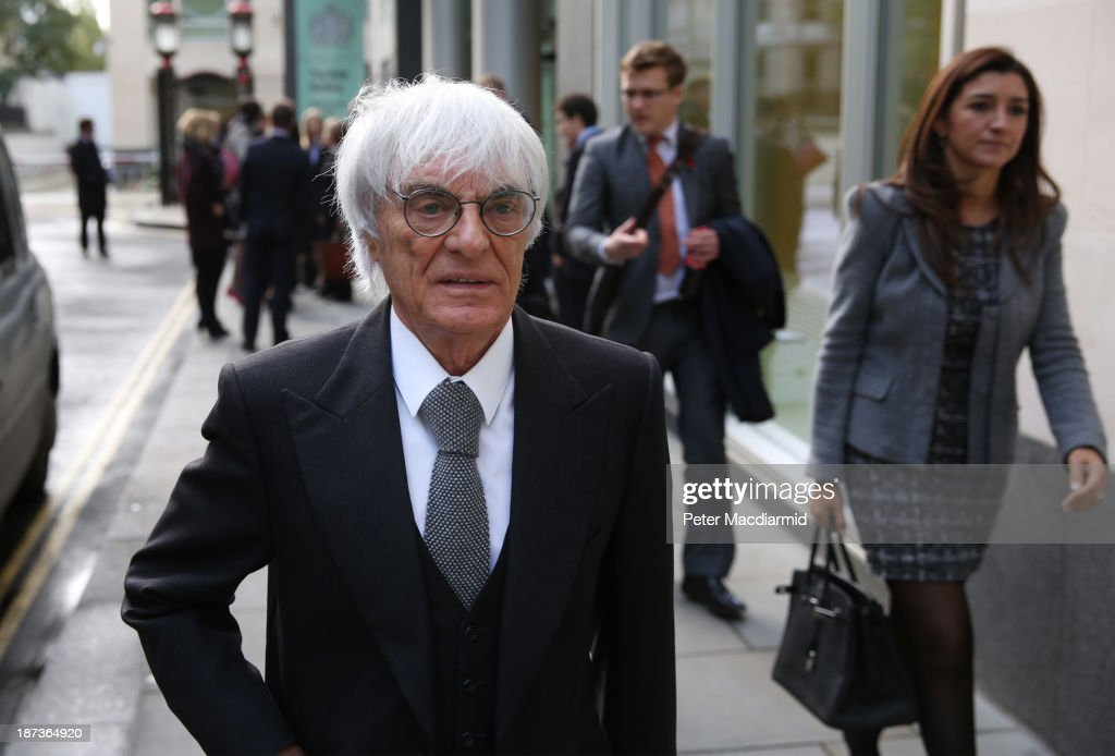 Formula One boss <a gi-track='captionPersonalityLinkClicked' href=/galleries/search?phrase=Bernie+Ecclestone&family=editorial&specificpeople=211579 ng-click='$event.stopPropagation()'>Bernie Ecclestone</a> makes an unexpected departure from court with his wife <a gi-track='captionPersonalityLinkClicked' href=/galleries/search?phrase=Fabiana+Flosi&family=editorial&specificpeople=6676248 ng-click='$event.stopPropagation()'>Fabiana Flosi</a> (R) after a fire alarm cleared the Rolls Building of the High Court on November 8, 2013 in London, England. Mr Ecclestone is defending himself in a £100 million case involving the sale of the formula one racing business in 2005.