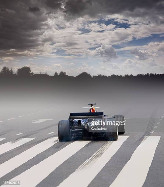 Formula one car with fog at the starting line