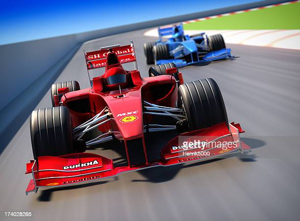 Formula One cars racing, clipping path included