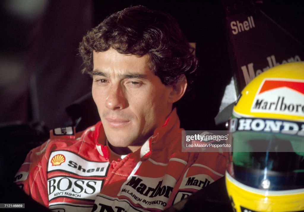 Formula One driver Ayrton Senna (1960-1994) of Brazil pictured sitting in the driver's seat of his Honda Marlboro McLaren racing car with his custom racing helmet during testing in Jerez, Spain, circa February 1991.