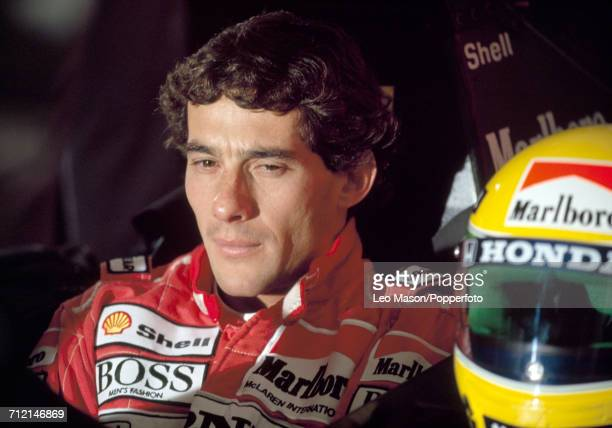 Formula One driver Ayrton Senna of Brazil pictured sitting in the driver's seat of his Honda Marlboro McLaren racing car with his custom racing...