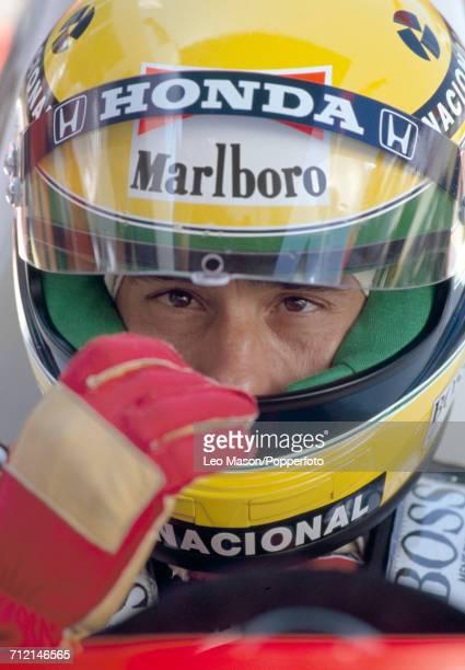 Formula One driver Ayrton Senna of Brazil pictured wearing his custom racing helmet during testing in Jerez Spain circa February 1991