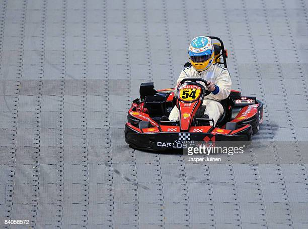 Formula one driver Fernando Alonso steers a kart during the 'Iker Vs Rafa' charity game at the Palacio de Deportes de la Comunidad de Madrid on...