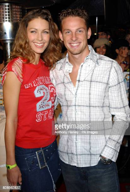 Formula One driver Jenson Button and his girlfriend Louise Griffiths arrive for the MTV Europe Music Awards at Palau Sant Jordi pavillion These are...