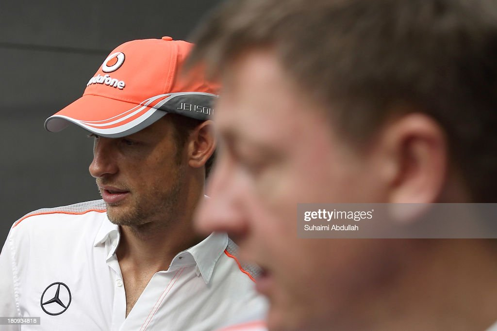 Formula One driver <a gi-track='captionPersonalityLinkClicked' href=/galleries/search?phrase=Jenson+Button&family=editorial&specificpeople=171505 ng-click='$event.stopPropagation()'>Jenson Button</a> of Great Britain and McLaren (L) attends the press conference during 'The One Legacy Tour' at ION Orchard on September 18, 2013 in Singapore.