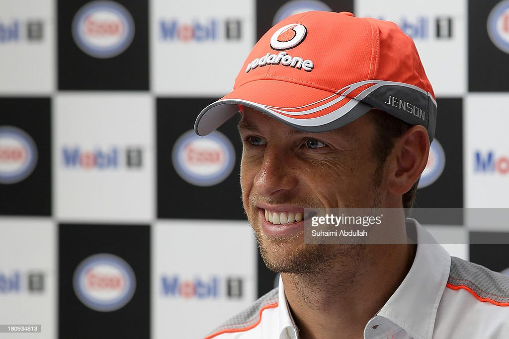 Formula One driver Jenson Button of Great Britain and McLaren speaks to the media during 'The One Legacy Tour' at ION Orchard on September 18, 2013 in Singapore.