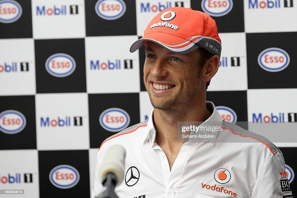 Formula One driver <a gi-track='captionPersonalityLinkClicked' href=/galleries/search?phrase=Jenson+Button&family=editorial&specificpeople=171505 ng-click='$event.stopPropagation()'>Jenson Button</a> of Great Britain and McLaren speaks to the media during 'The One Legacy Tour' at ION Orchard on September 18, 2013 in Singapore.