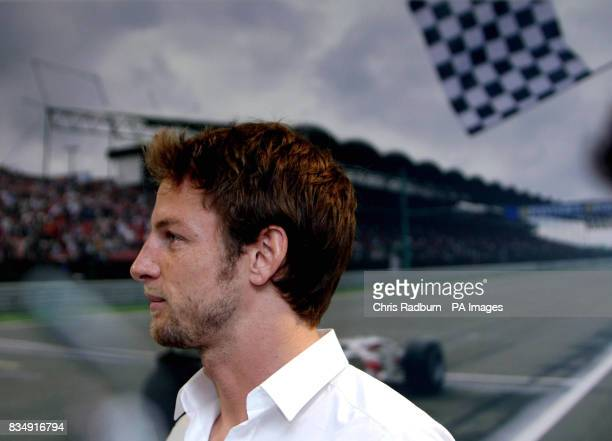Formula One Driver Jenson Button speaks to his Team Mechanics at the F1 Honda Racing Team headquarters at Brackley Northamptonshire