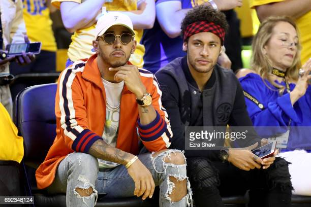 Formula One driver Lewis Hamilton and FC Barcelona football player Neymar Jr attend Game 2 of the 2017 NBA Finals at ORACLE Arena on June 4 2017 in...