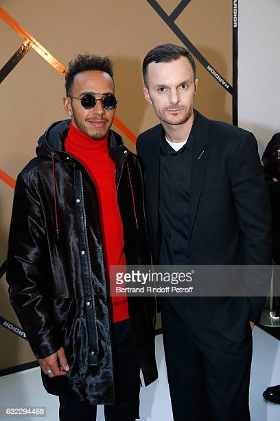 Formula One driver Lewis Hamilton and Stylist Kris Van Assche pose backstage after the Dior Homme Menswear Fall/Winter 20172018 show as part of Paris...
