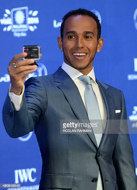 Formula One driver Lewis Hamilton of Britain attends the 2014 Laureus World Sports Awards at the Istana Budaya Theatre on March 26 2014 in Kuala...