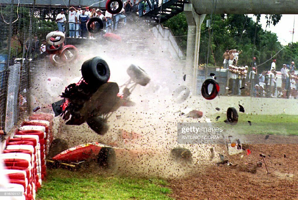 S Formula One driver Michael Andretti goes airborne in his McLaren 28 March 1993 as Austrian driver Gerard Berger hits the retaining in his Ferrari...