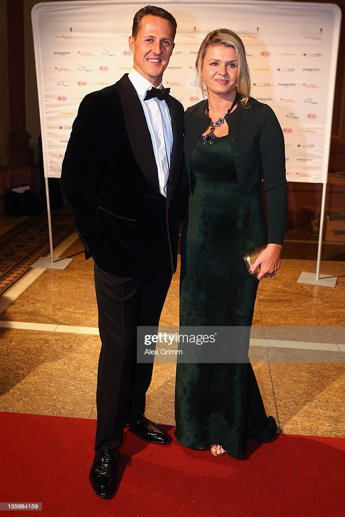Formula One driver <a gi-track='captionPersonalityLinkClicked' href=/galleries/search?phrase=Michael+Schumacher&family=editorial&specificpeople=157602 ng-click='$event.stopPropagation()'>Michael Schumacher</a> and his wife Corinna pose during the 31. Sportpresseball at Alte Oper on November 10, 2012 in Frankfurt am Main, Germany.