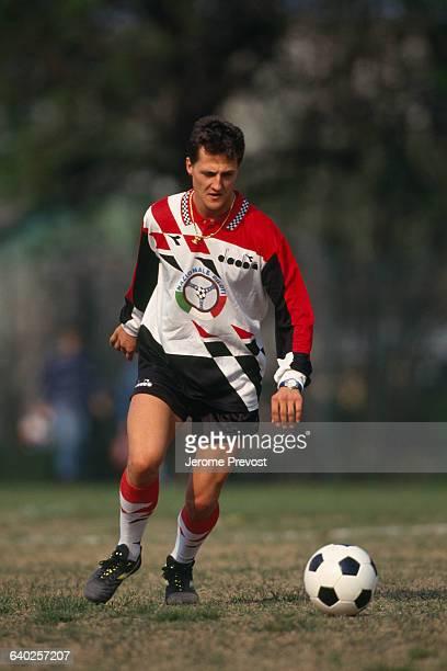 Formula One driver Michael Schumacher playing soccer