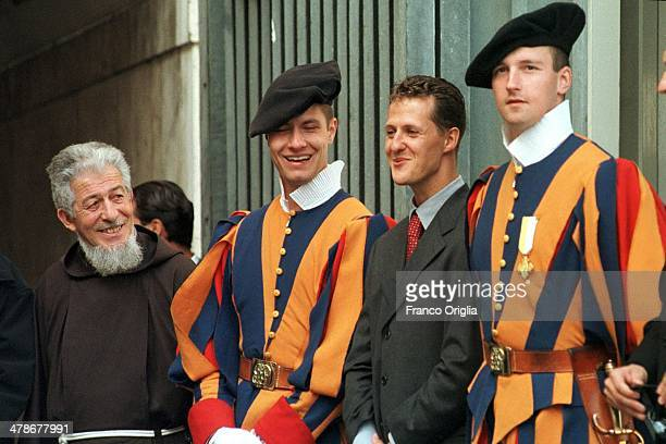 Formula One driver Michael Schumacher poses with two Swiss guards during an audience with Pope John Paul II in St Peter's Square on October 6 1999 in...