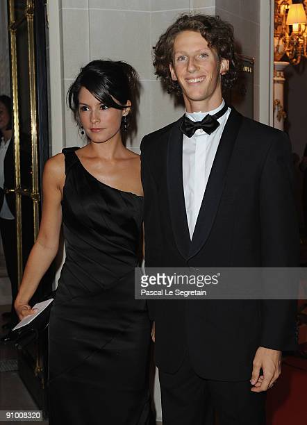 Formula one driver Romain Grosjean and girlfriend Marion Jolles pose as they arrive to attend the 'Par Coeur Gala' dinner at the Hotel Meurice on...
