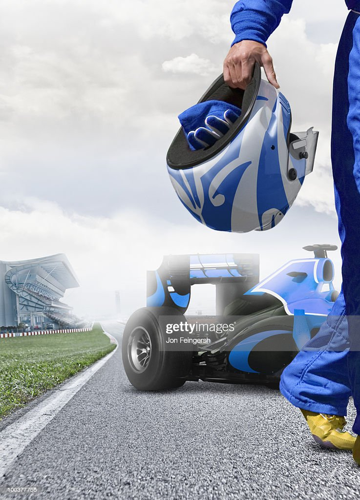Formula One Driver Walking Away from Car  : Stock Photo
