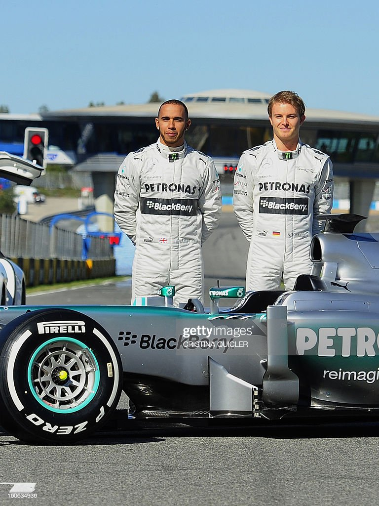 Formula One drivers, German Nico Rosberg (R) and British Lewis Hamilton (L) pose with the new Mercedes W04 as part of the Formula One training session at Jerez racetrack, on February 4, 2013 in Jerez de la Frontera.