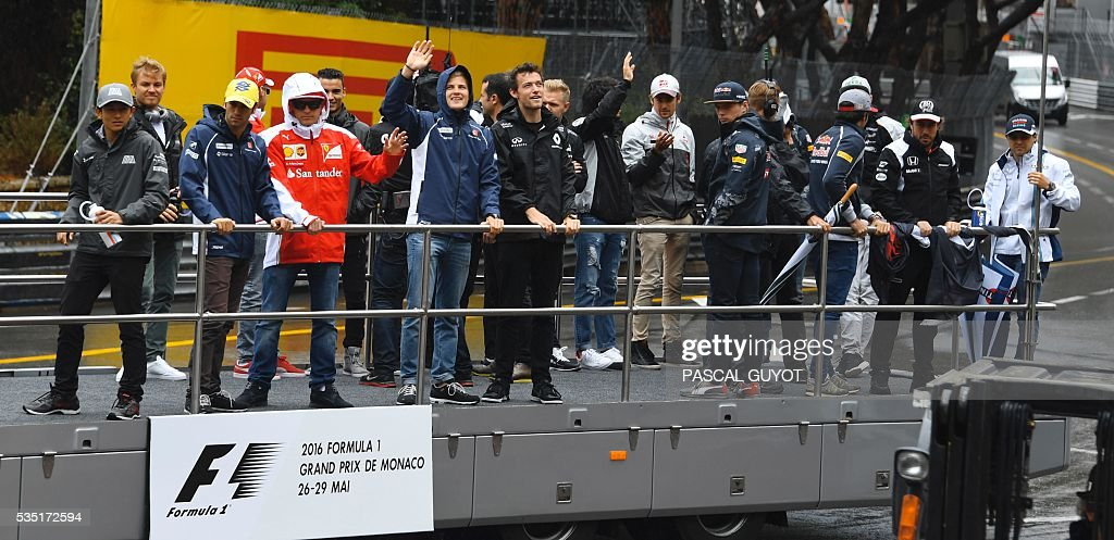 Formula One drivers parade at the Monaco street circuit, on May 29, 2016 in Monaco, ahead of the Monaco Formula 1 Grand Prix. / AFP / PASCAL