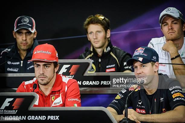 Formula One drivers WilliamsRenault driver Pastor Maldonado of Venezuela LotusRenault driver Romain Grosjean of France MercedesAMG driver Nico...