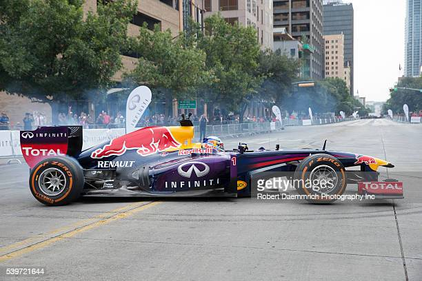 Formula One Infiniti Red Bull racing driver Sebastian Vettel turns doughnuts on Congress Avenue in Austin Texas with a twoyear car during a promotion...