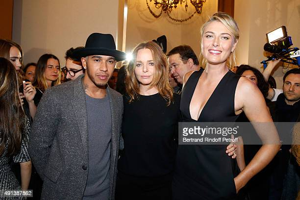 Formula One Pilot Lewis Hamilton Fashion Designer Stella McCartney and Tennis Player Maria Sharapova pose Backstage after the Stella McCartney show...