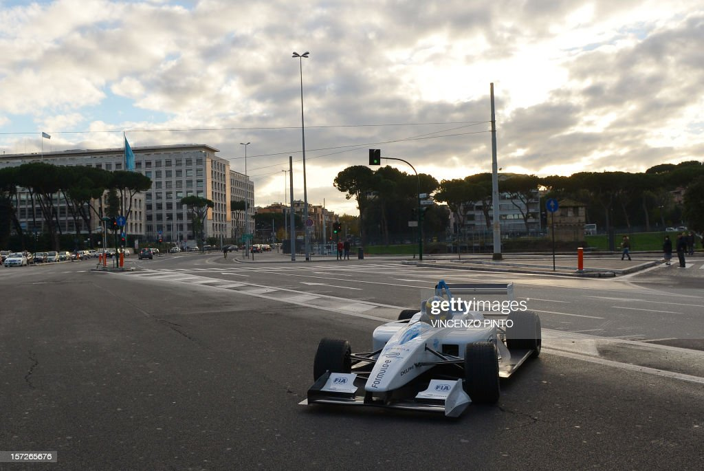 Formula One Pirelli test driver Lucas Di Grassi drives the Formula E electric car prototype, the Formulec, past the World Food Programme office in Rome on December 1, 2012, prior to an electric car race event in the Italian capital. Electric racing cars speed through Rome for a presentation of a 'Formula E' championship to be held in the Italian capital and nine other cities in 2014.
