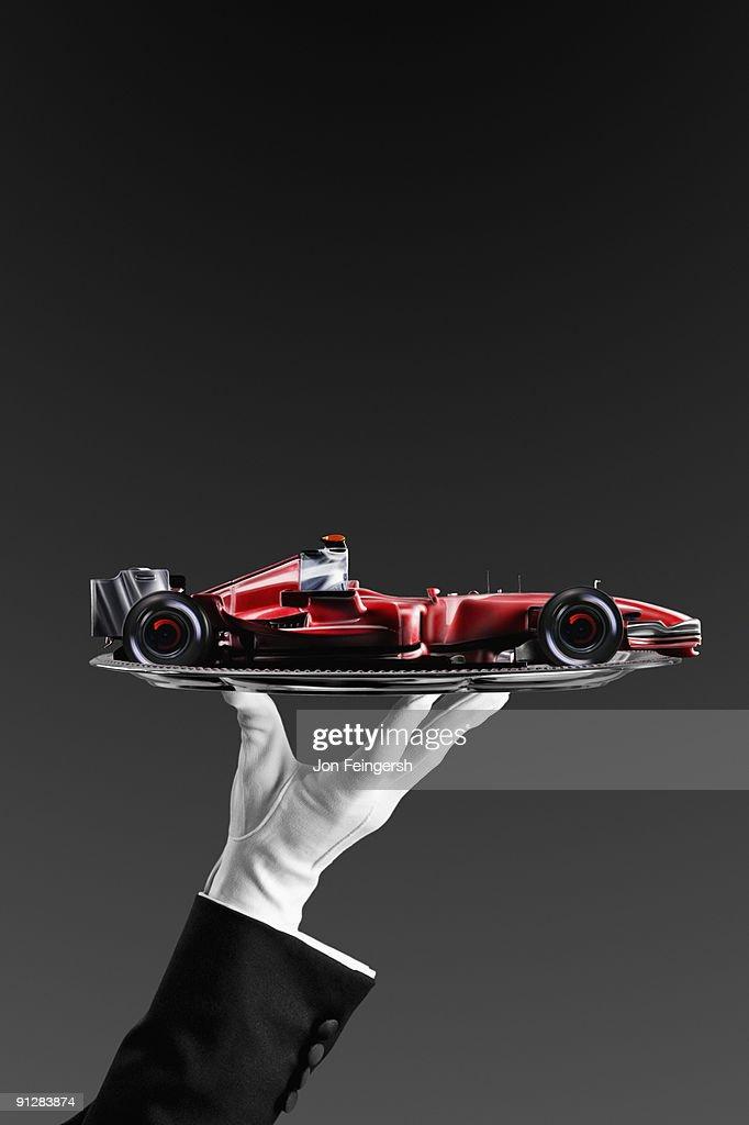 Formula One race car on silver platter.