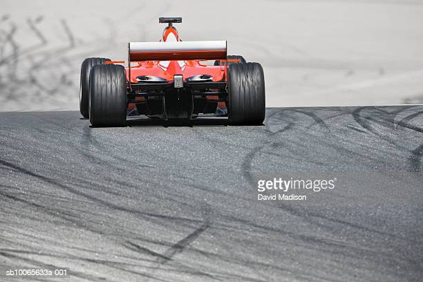 Formula One race car on track with skid marks