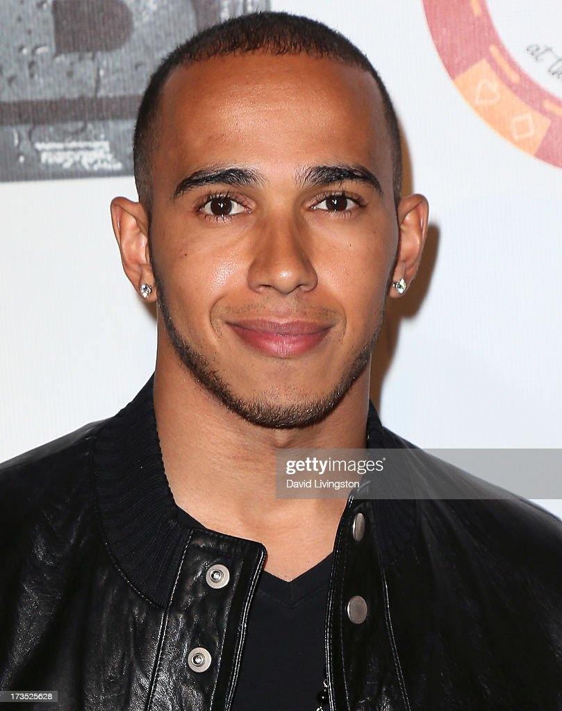 Formula One race driver Lewis Hamilton attends the 8th Annual BTE All-Star Celebrity Kickoff Party at the Playboy Mansion on July 15, 2013 in Beverly Hills, California.