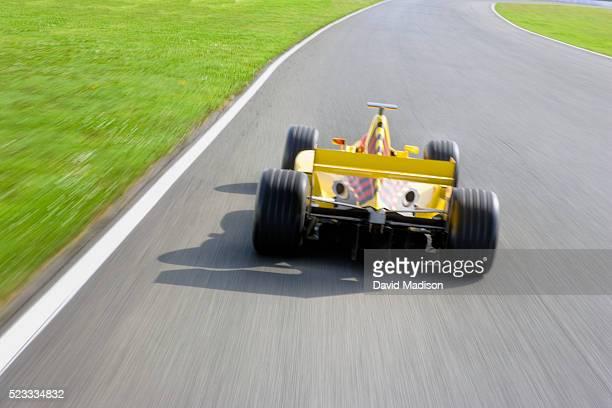 Formula One Racecar on Racetrack