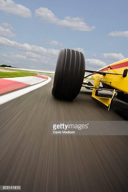 Formula One Racecar Speeding Through Corner
