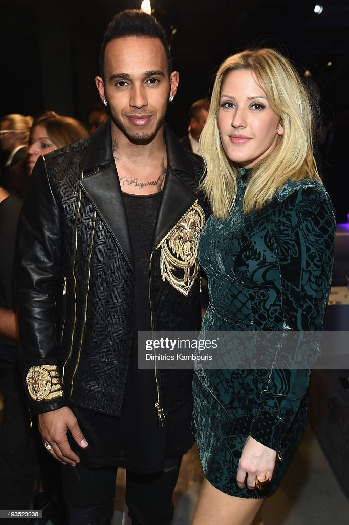 Formula One racing driver Lewis Hamilton (L) and Singer Ellie Goulding attends the BALMAIN X H&M Collection Launch at 23 Wall Street on October 20, 2015 in New York City.